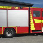 Fahrzeugbeschriftung und Warnmarkierung Feuerwehr